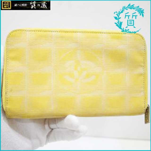 シャネルCHANELのニュートラベル長財布!黄色買取価格